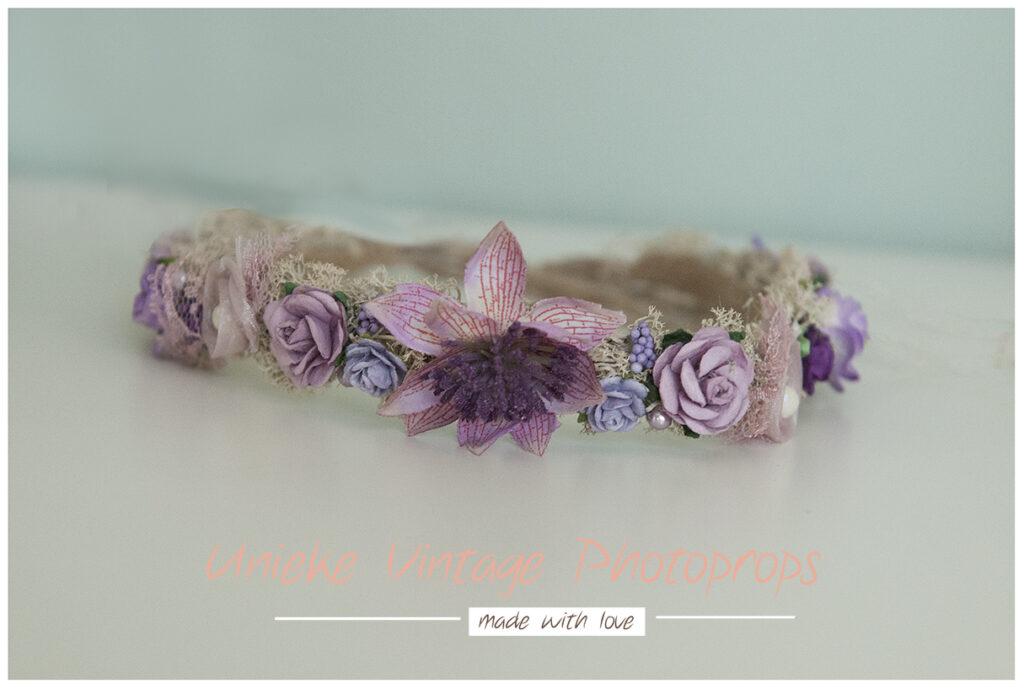 Bloemenkransje lila en paarstinten nb en sitters
