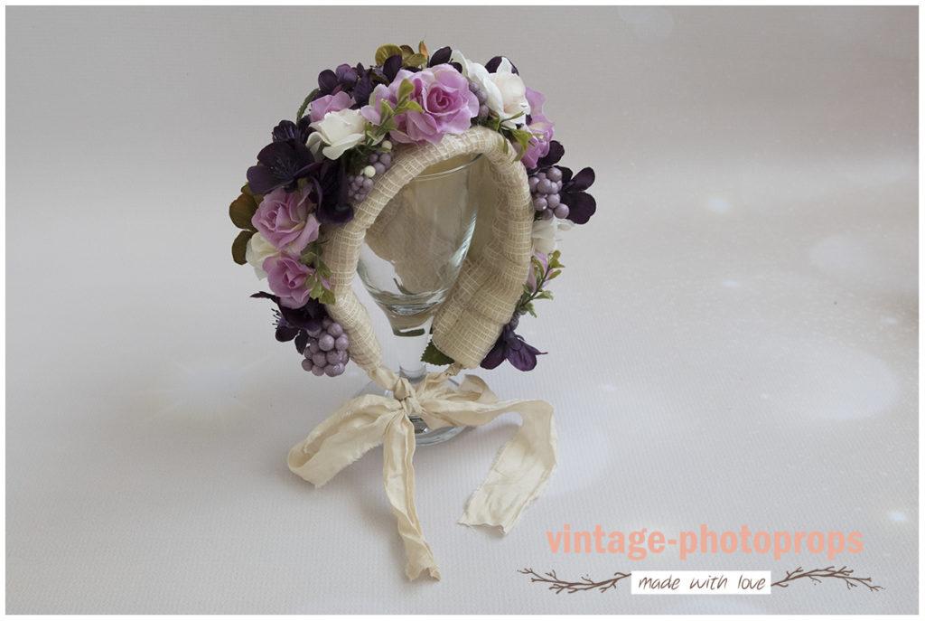 Bloemenbonnet newborn purple/magenta