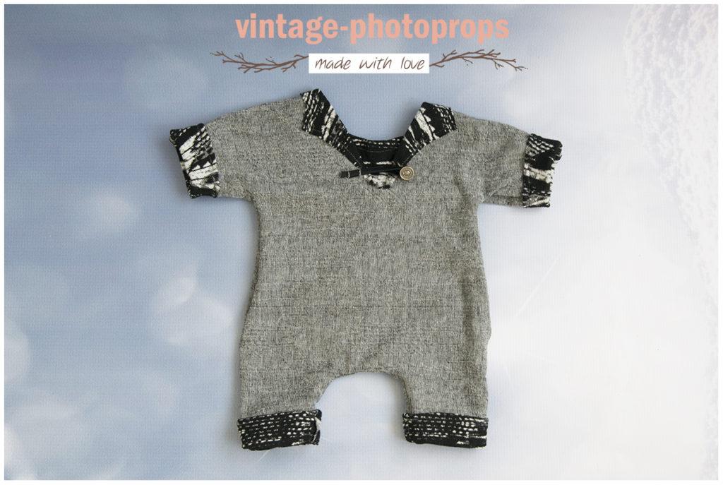 Newbornpakje grijs met zwart gemeleerd maat 50